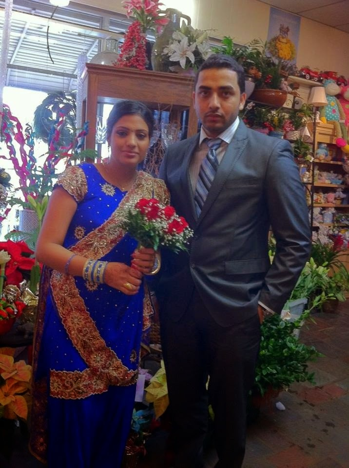 Bride & Groom of a traditional Indian wedding with flowers by Stein Your Florist Co.