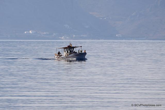 Lone fisherman coming back