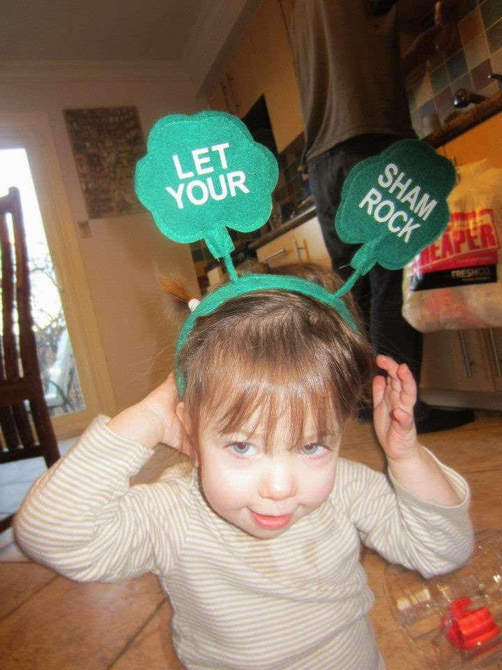 toddler with shamrock st. paddys day hat