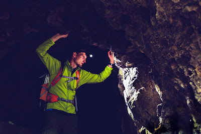Man in Icelandic cave with headlamp