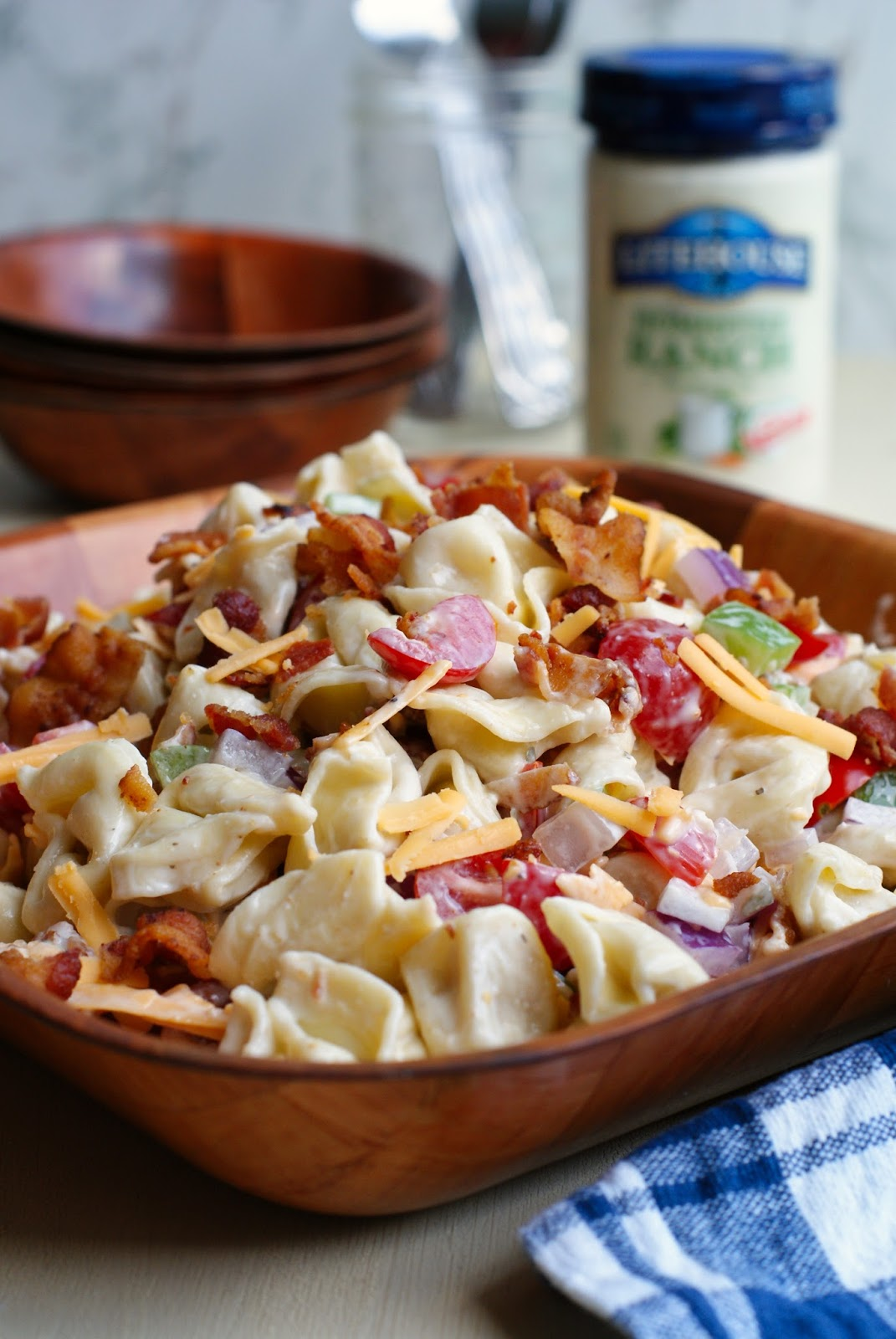 Bacon Ranch Tortellini Salad is a party perfect pasta salad that pairs cheese-filled tortellini with fresh veggies, cheddar cheese, cool ranch dressing, and lots of crisp crumbled bacon! SeeTheLight AD