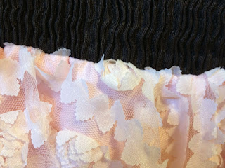 up close of 3 inch waistband and lace flower chiffon with satin underlay
