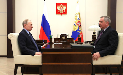 Vladimir Putin meeting with Deputy Prime Minister Dmitry Rogozin.
