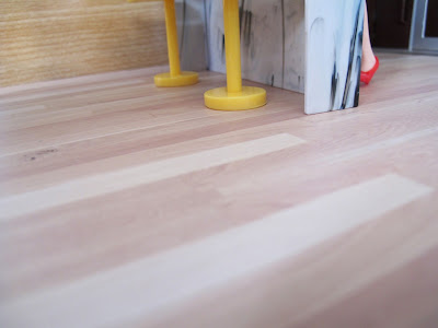 The wood-printed floor of the modern Lori Loft to Love dolls' house.