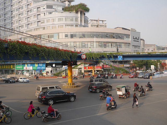 Vehicles and a pedestrian headed toward Yuanda 1st Road