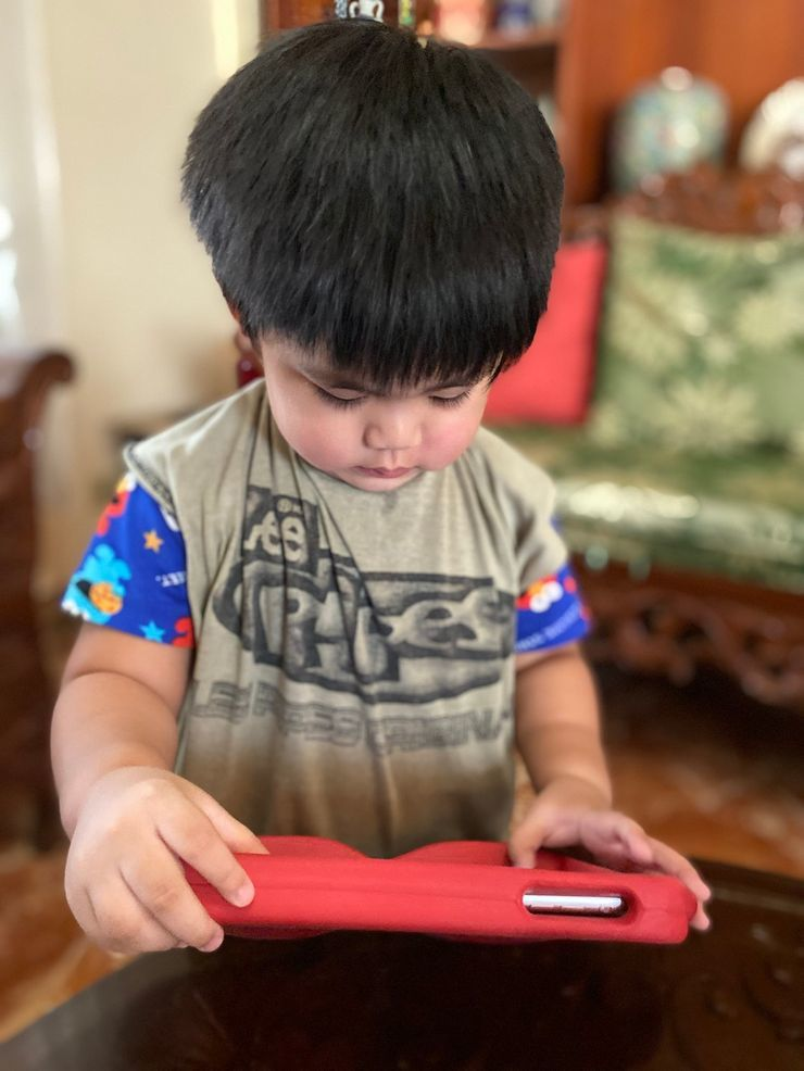 A tablet or video of children's songs to distract your toddler during haircut