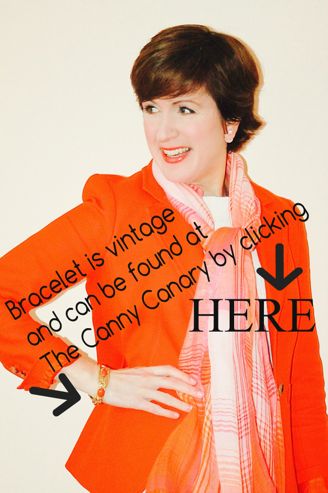 Fashion blogger modeling orange jacket