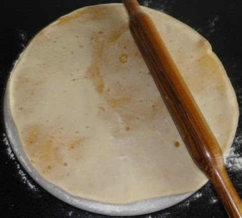 puran poli rolled to thin