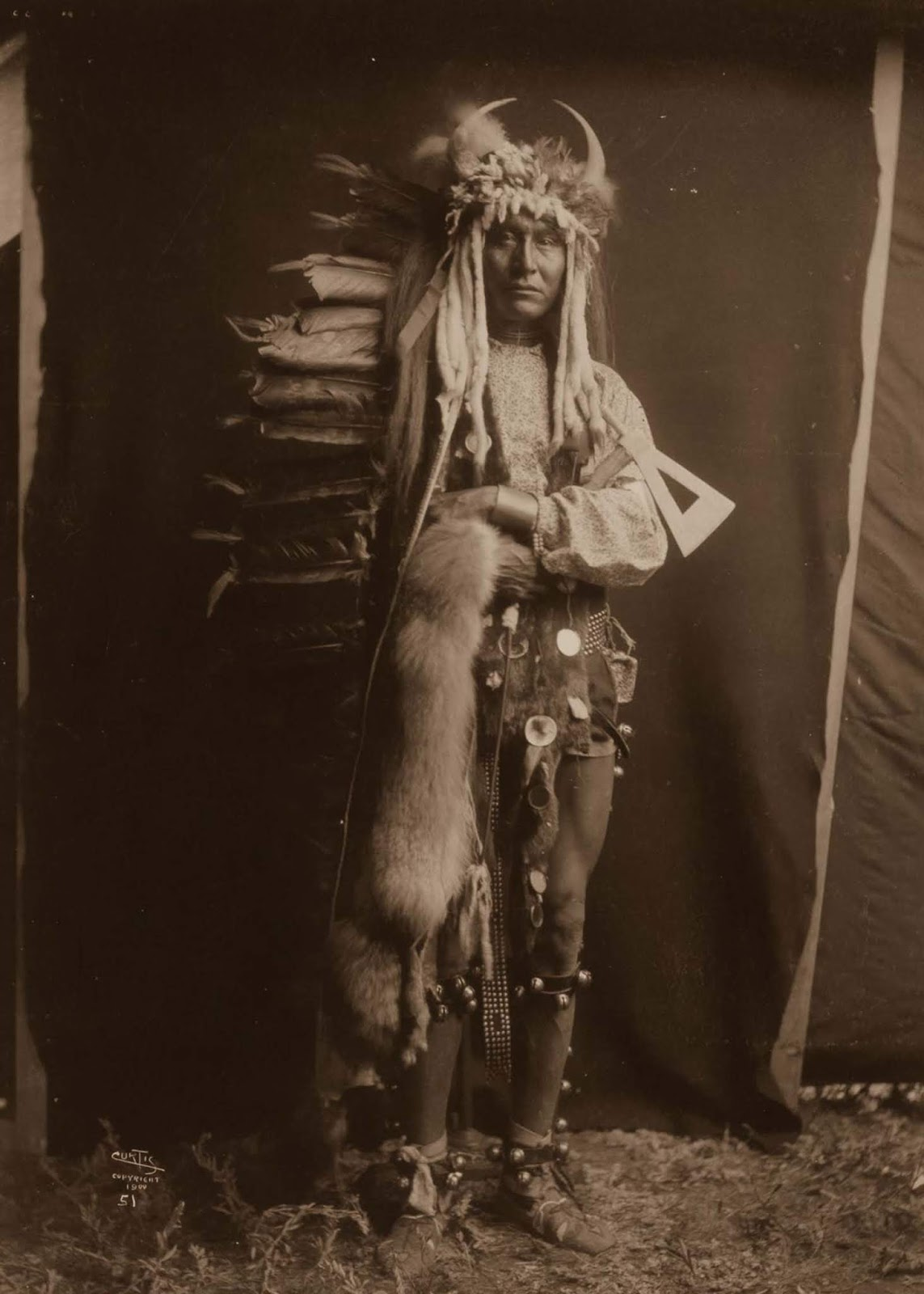 Iron Breast, a Piegan man. 1900.