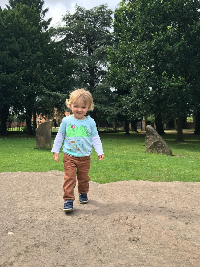 Tredegar-House-&-gardens-a-toddler-on-huge-stone-in-the-centre-of-the-gorsedd