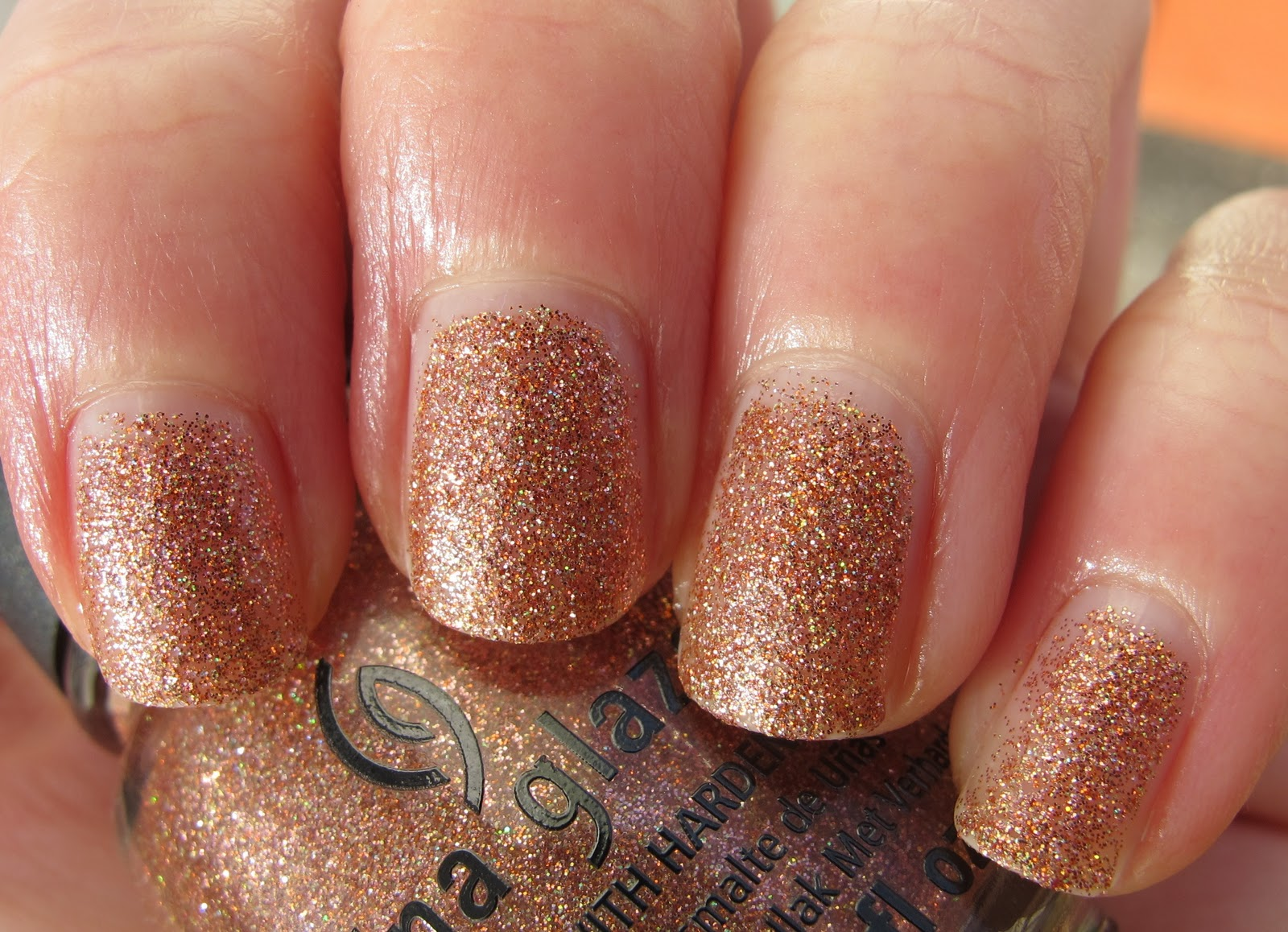 china glaze fireside glow is a gorgeous copper holo glitter polish in a clear base i dont own anything remotely like this at all