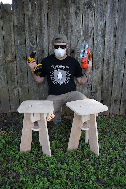 ConcatLab author crouched behind two flatpack stools and holding a jigsaw and drill