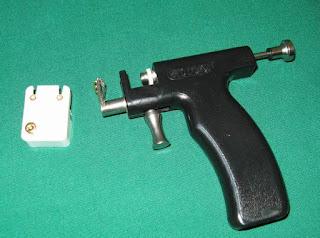 Tragus piercing pain with Gun