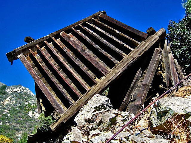 This is Allison Mine's old collapsed ore hopper. There are numerous artifacts surrounding it.