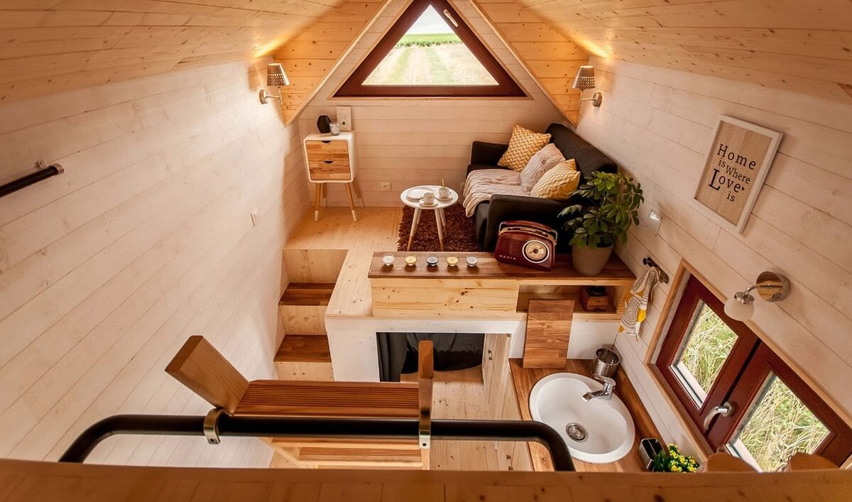02-Living-Room-and-Kitchen-Baluchon-Multi-Level-Prefabricated-Tiny-House-on-Wheels-www-designstack-co