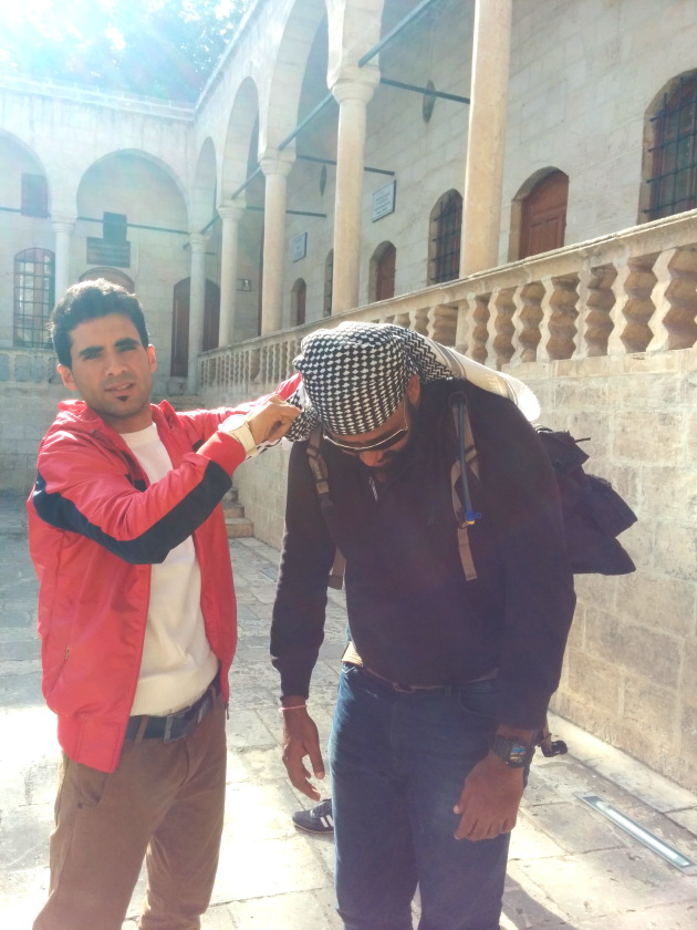 My local friend helping me tie a Kurdi turban