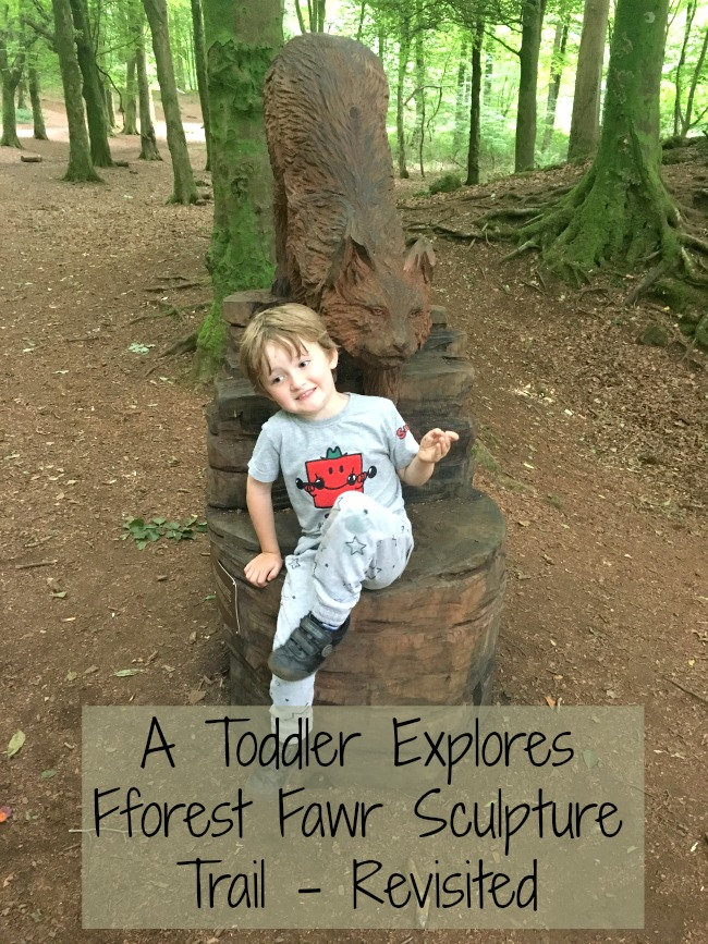 A-Toddler-Explores-Fforest-Fawr-Sculpture-Trail-Revisited-text-over-image-of-boy-on-fox-sculpture