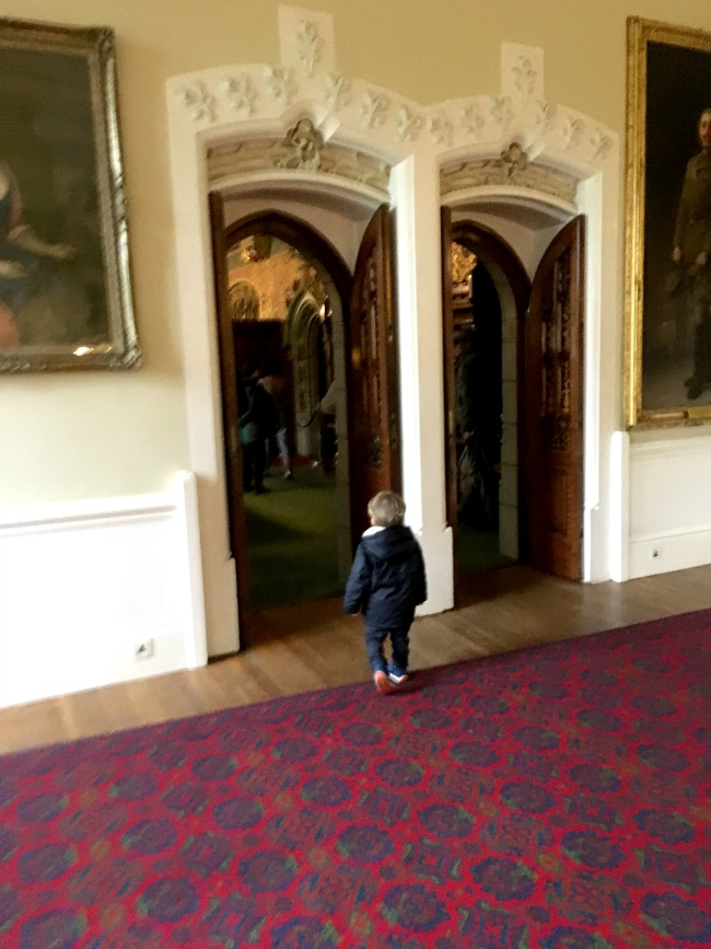 Cardiff-Castle-toddler-walking-through-doorway