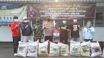 Polresta Tangerang distribusikan bansos untuk buruh PT. Victory Chingluh Indonesia