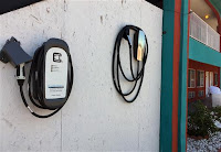 A charging station is shown on July 13 at the Sandia Peak Inn along Albuquerque's Route 66. The 2,500-mile route is seeing a growing number of electric car charging stations, and some states are even pushing for solar panels and electric buses. (Credit: Russell Contreras/AP) Click to Enlarge.