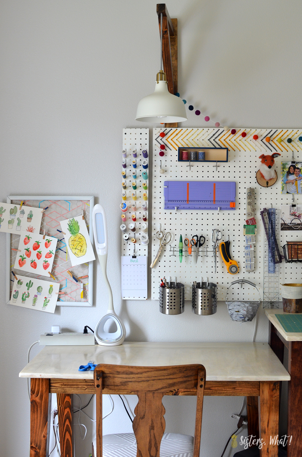 a fun craft area using a pegboard as craft storage and sewing supply storage