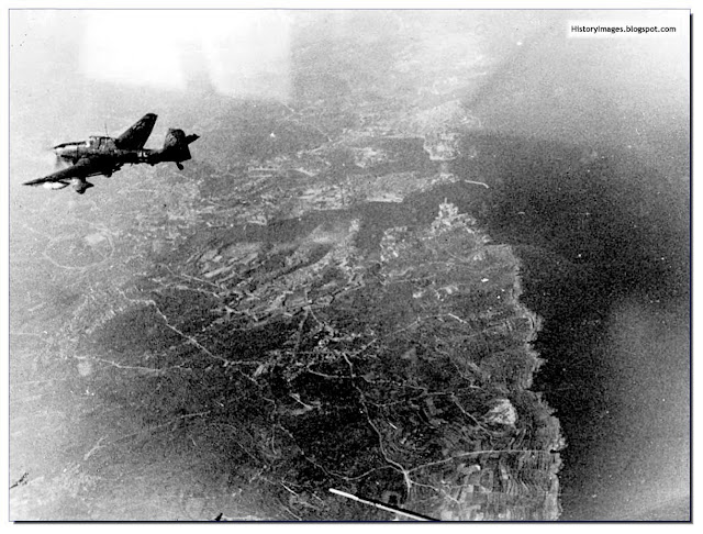German Stuka Dive Bomber flies over Valletta, the capital of British Malta in 1941