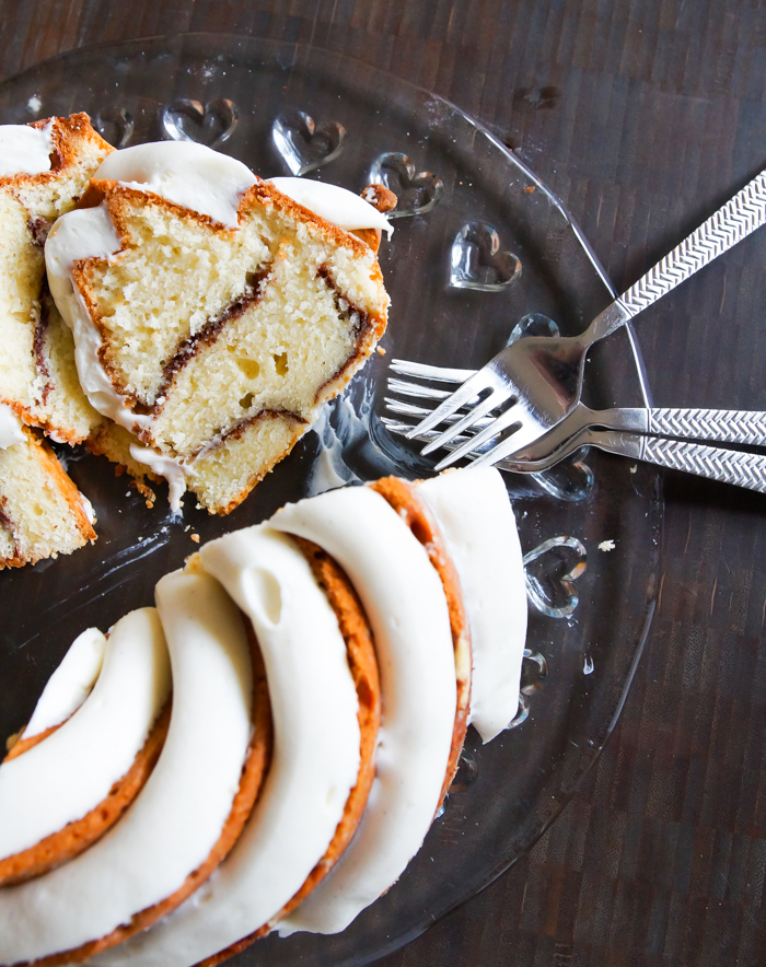 Cinnamon Roll Bundt Cake with a thick, vanilla bean-cream cheese frosting. | bakeat350.net