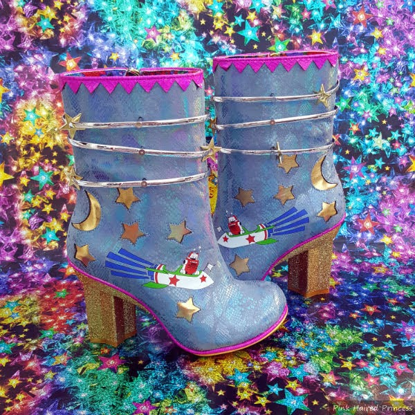 blue boots with gold stars and moon on bright starry background