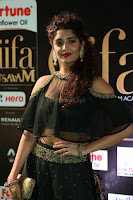 Ritika Singh in a Ethnic Deep Neck Dark Green Choli Ghagra at IIFA Utsavam Awards March 2017 ~ 041.JPG