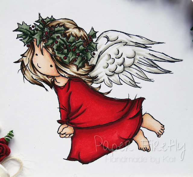 Christmas angel in traditional red and green (image from LOTV)