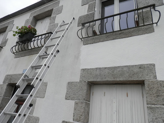 painting the exterior of an old french house