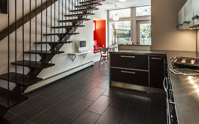 Dark wood floor with wide planks enhances the contemporary feel of this room