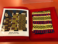 a two page layout with printed image of art by Alfred Jensen, titled Atlantis, Per II, 1965, on the left. On the right side is a tactile representation made of woven string in vertical lines of yellow, black, blue and red