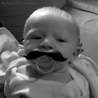 Baby dummy pacifier mustache photo