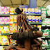 PHOTOS: Striking Photographs Show African Tribeswoman Pick Up Some Supermarket Essentials