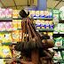 PHOTOS: Striking Photographs Show African Tribeswoman Pick Up Some Supermarket Essentials