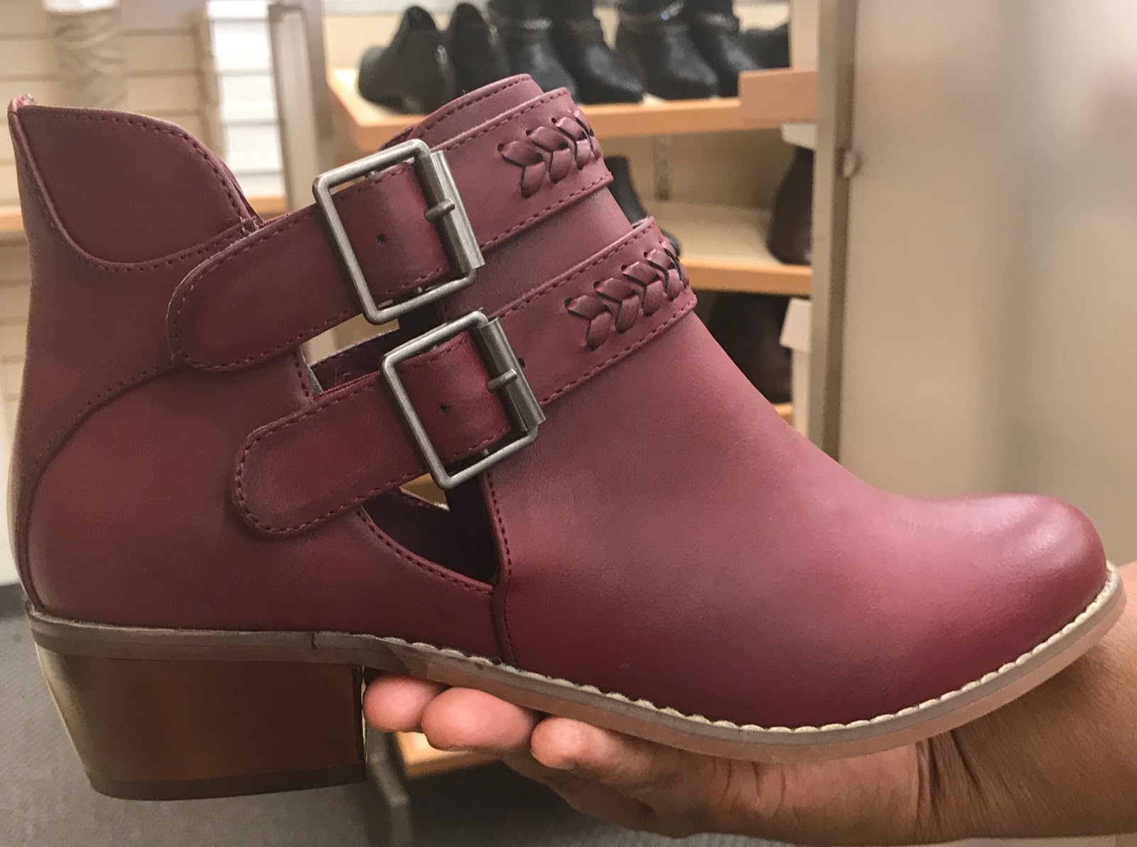Image: Woman tries on booties for the fall season