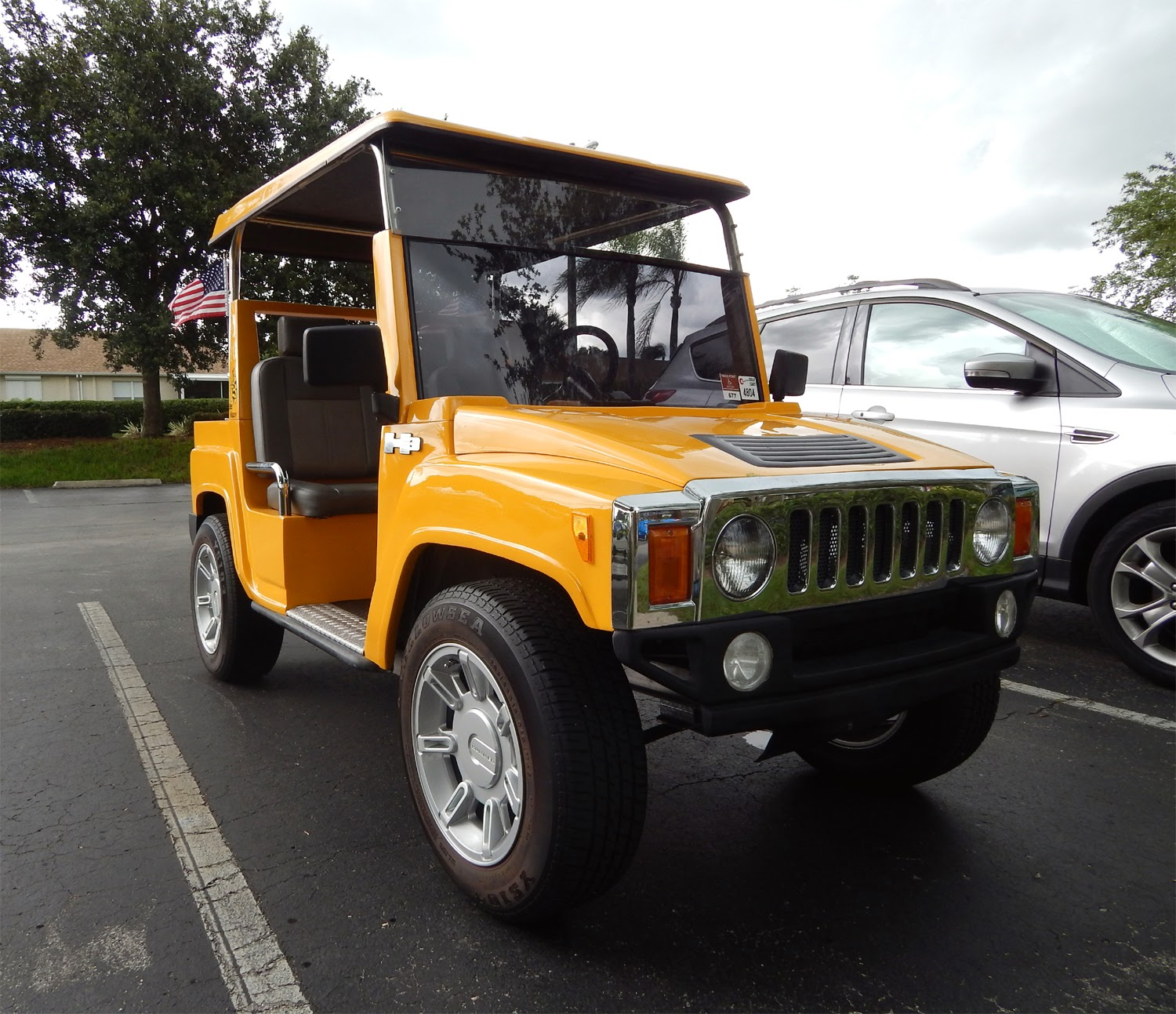 Yellow H3 Hummer Golf Cart says Bee Happy in Sun City Center