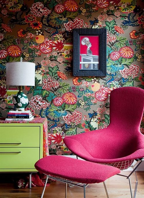 pink armchair with floral print wallpaper