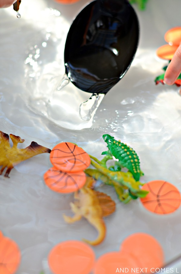 Fine motor water sensory play for toddlers and preschoolers using dinosaurs and basketballs from And Next Comes L