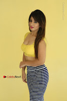 Cute Telugu Actress Shunaya Solanki High Definition Spicy Pos in Yellow Top and Skirt  0089.JPG
