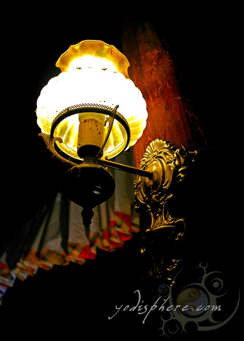 hover_share Antique wall lamp inside Casa de Don Emilio antique Spanish house