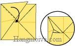 Bước 9: Gấp, nhét cạnh giấy vào trong khe giấy.