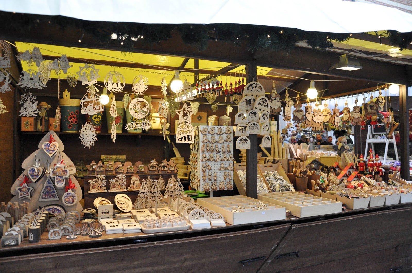 A stall with Christmas decorations made of wood, Nuremberg Christmas market, Verona, Italy