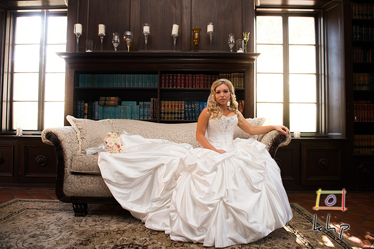 The bride in all her glamour and beauty took her place on the couch in the Villa's library.