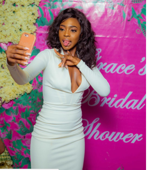 Braless Beverly Osu bares her cleavage in new photo