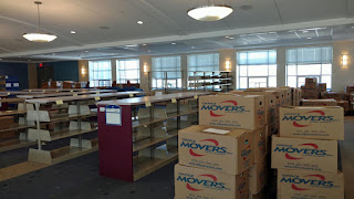 Shelves and boxes of books at Wheaton Interim Library