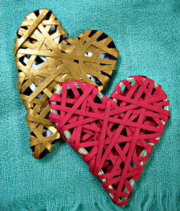 two heart shapes wrapped randomly with red and gold quilling paper strips