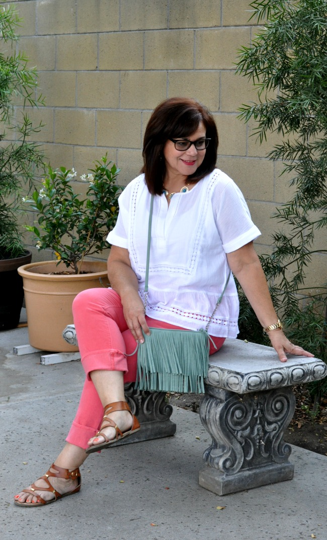 coral skinny ankle pants and white cotton top