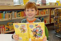 Boy holding a PAW Patrol book